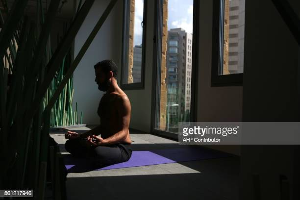 A Lebanese man practises Yoga in Beit Beirut on October 14 during an installation dubbed Healing Lebanon by local artist Zena elKhalil in the capital...
