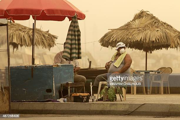 A Lebanese man wears a mask to protect himself from the dust as a sandstorm blows over the northern Lebanese city of Tripoli on September 8 2015