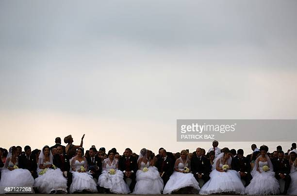 Lebanese Maronite Christian couples take part in a mass wedding at the Maronite Patriarchate in Bkerke on September 6 2015 Thirtyseven couples got...