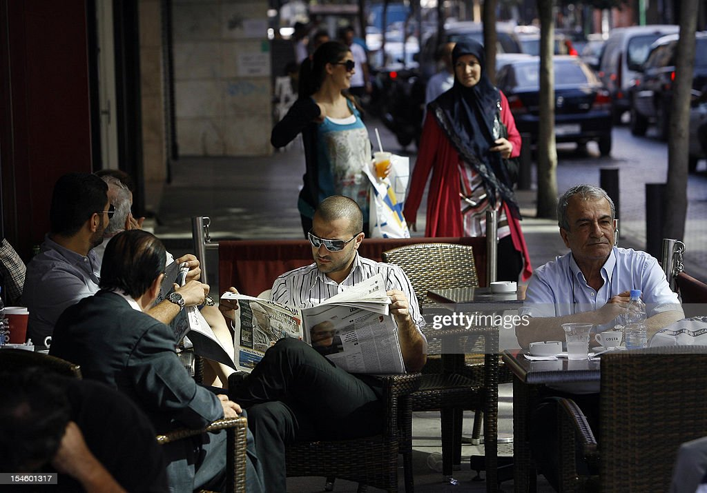 Lebanese men sit at a cafe on Hamra Street in Beirut on October 23, 2012 as life returned to normal, days after a car bomb blast in the Lebanese capital. The Lebanese army said it was determined to restore order in the country which has been roiled by growing political tensions linked to neighbouring Syria. AFP PHOTO/STR