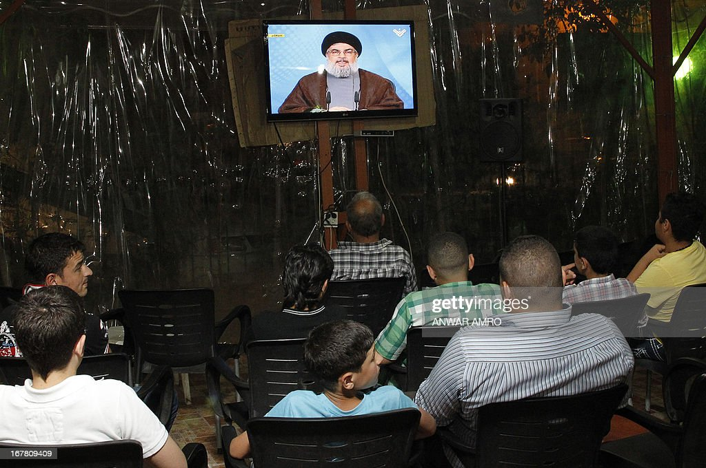 Lebanese men watch Hezbollah leader Hassan Nasrallah delivering a televised speech at a cafe in Beirut on April 30, 2013. The chief of powerful Lebanese Shiite Muslim party Hezbollah, a close Damascus ally, said that Syria's friends would not let the embattled regime of President Bashar al-Assad fall.
