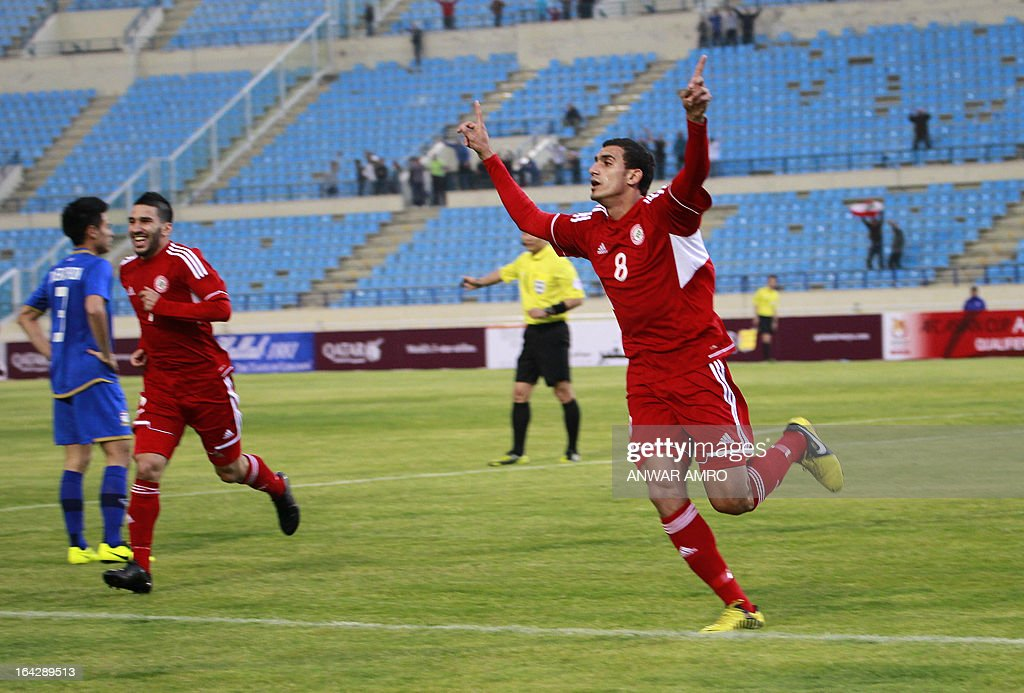 Lebanese midfielder Hassan Chaito (R) celebrates after scoring a goal against Thailand during their Asian Cup 2015 Qualifiers match at Sports City Stadium in Beirut on March 22, 2013. Lebanon defeated Thailand 5-2.