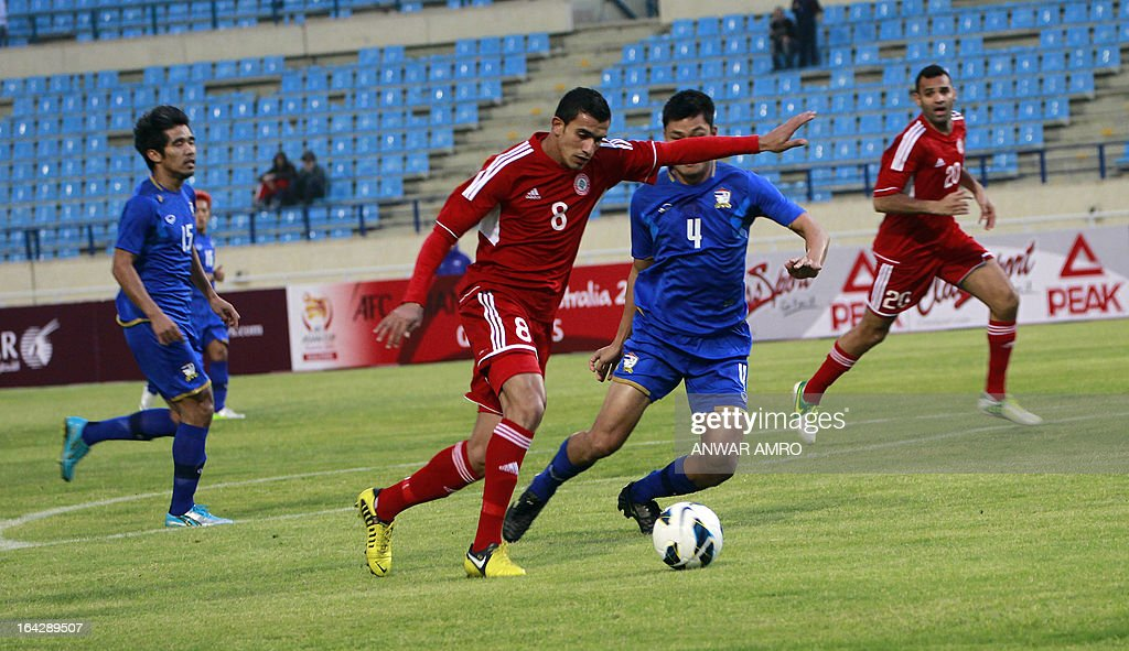 Lebanese midfielder Hassan Chaito (C) vies for the ball against Thailand's defender Apiwat Ngualamhin (C-R) during their Asian Cup 2015 Qualifiers match at Sports City Stadium in Beirut on March 22, 2013. Lebanon defeated Thailand 5-2.