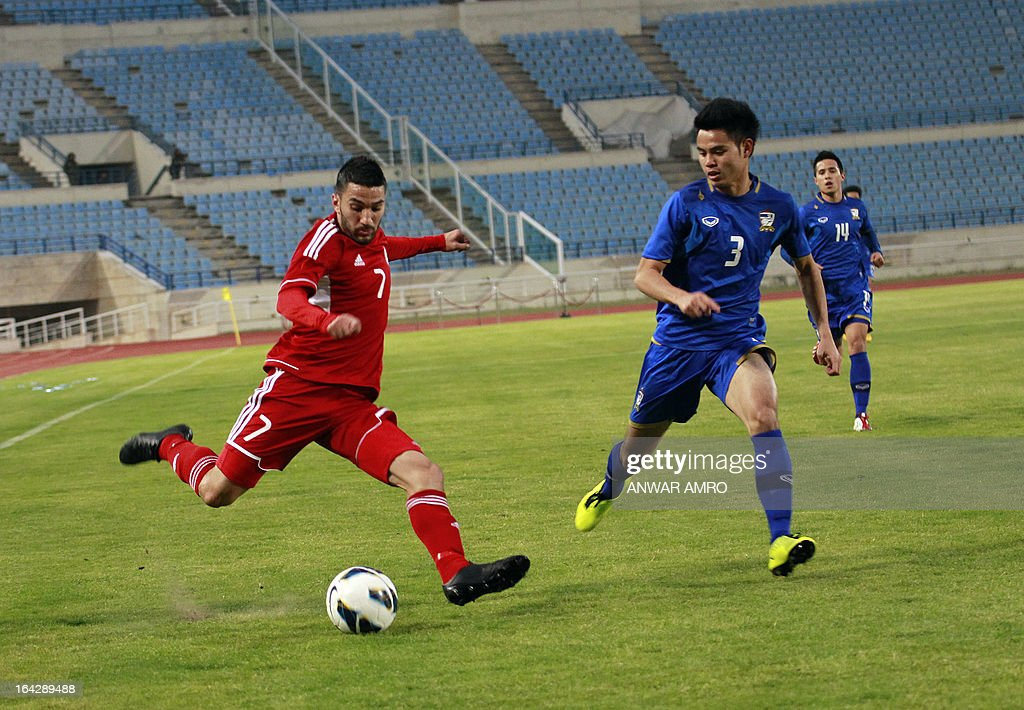 Lebanese midfielder Hassan Maatouk (L) vies for the ball against Thailand's defender Bunmathan during their Asian Cup 2015 Qualifiers match at Sports City Stadium in Beirut on March 22, 2013. Lebanon defeated Thailand 5-2. AFP PHOTO/ ANWAR AMRO