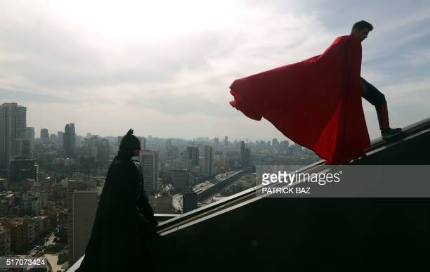 Lebanese models dressed as Batman and Superman play on the rooftop of a building during a photoshoot in the capital Beirut on March 23 2016 / AFP /...
