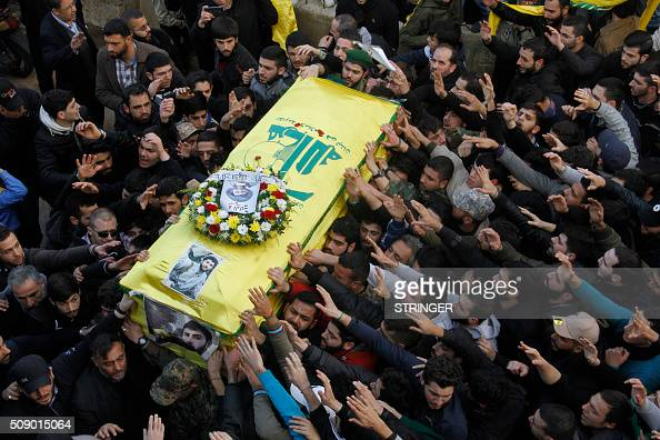 TOPSHOT Lebanese mourners attend the funeral of Mohammad Ibrahim a member of Lebanon's militant Shiite Muslim movement Hezbollah who was killed in...