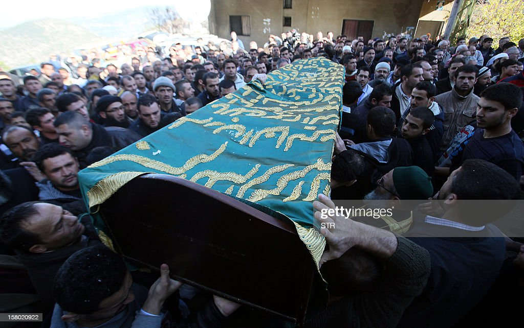 Lebanese mourners carry the coffin of Abdel Hamid Ali al-Agha, who was among a group of Sunni Muslims killed by the Syrian army after they crossed into Syria to fight alongside rebels, during his funeral in Denniyeh in northern Lebanon on December 9, 2012. The 22 men died in Tal Kalakh in the central Syrian province of Homs late last month after travelling from the northern Lebanese city of Tripoli to join the rebellion against Syrian President Bashar al-Assad, according to a local official and an Islamist leader.