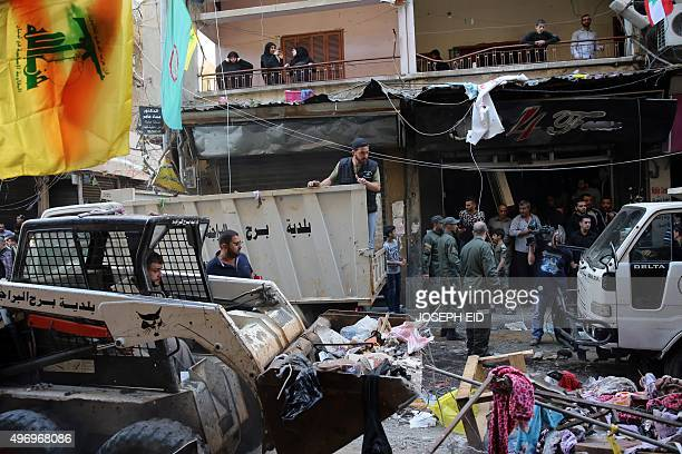 Lebanese municipality workers clear debris from the site of a twin bombing attack in the area of Burj alBarajneh in Beirut's southern suburb on...