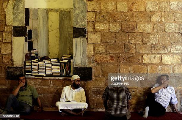 Lebanese Muslim men sit at the alMansouri Grand mosque in the northern port city of Tripoli on June 6 on the first day of the holy month of Ramadan...