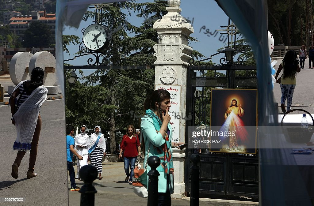 Lebanese Muslim Shiite women pay a visit to the shrine of Our Lady of Lebanon in the town of Harissa north east of the Lebanese capital Beirut, marking the start of the Holy Month of Virgin Mary, on May 1, 2016. Virgin Mary is considered one of the most righteous and greatest women in Islam and is venerated by both Islam and Christianity. / AFP / PATRICK BAZ