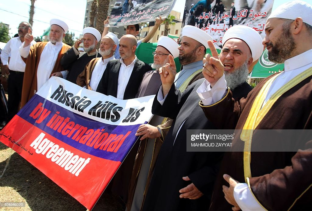 Lebanese Muslim Sunni clerics protest in Martyrs' Square in the southern city of Sidon on May 6, 2016, against the Syrian regime, Russia's support of the Syrian president and in solidarity with the victims of shelling in the northern Syrian city of Aleppo. ZAYYAT