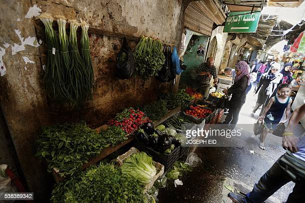 Lebanese Muslims shop prior to Iftar or breaking of the daylong fast in the old market in the ancient coastal city of Tripoli north of Beirut on June...