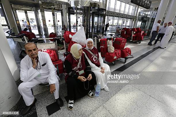 Lebanese Muslims sit near their luggage at Beirut International Airport as they head to perform the annual hajj pilgrimage in Saudi Arabia on...