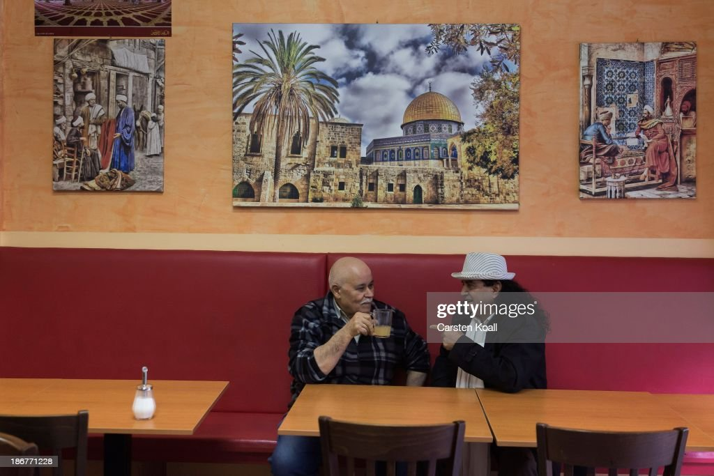 Lebanese native, bar owner Jakoubs Schoubi (L) drinks tea with the actor Ahmed Kraemer (R) at Sonnenallee in Neukoelln district on October 29, 2013 in Berlin, Germany. According to recently published statistics, 7.2 million foreigners were living in Germany by the end of 2012, which is the highest number ever recorded. Of those 80% are from countries in the European Union, while the rest come primarily from Turkey, Russia, the former Soviet states and Arab countries.