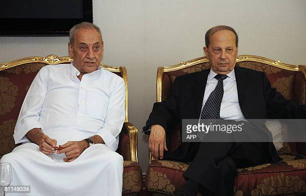 Lebanese Parliament Speaker and chief of Shiite Amal movement Nabih Berri sits next to Christian opposition leader General Michel Aoun during an...