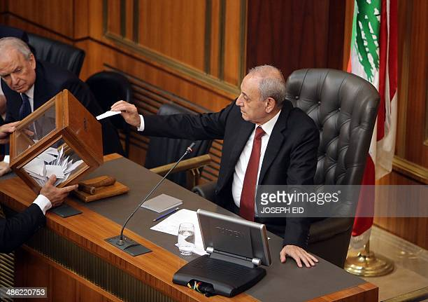 Lebanese parliament speaker Nabih Berri casts his vote to elect the new Lebanese president in the parliament building in downtown Beirut on April 23...