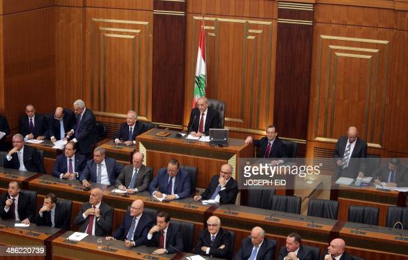 Lebanese parliament speaker Nabih Berri sits with members of parliament as they gather to elect the new Lebanese president in the parliament building...