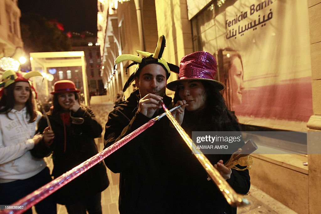 Lebanese people celebrate on new year's eve in Beirut, early on January 1, 2013.
