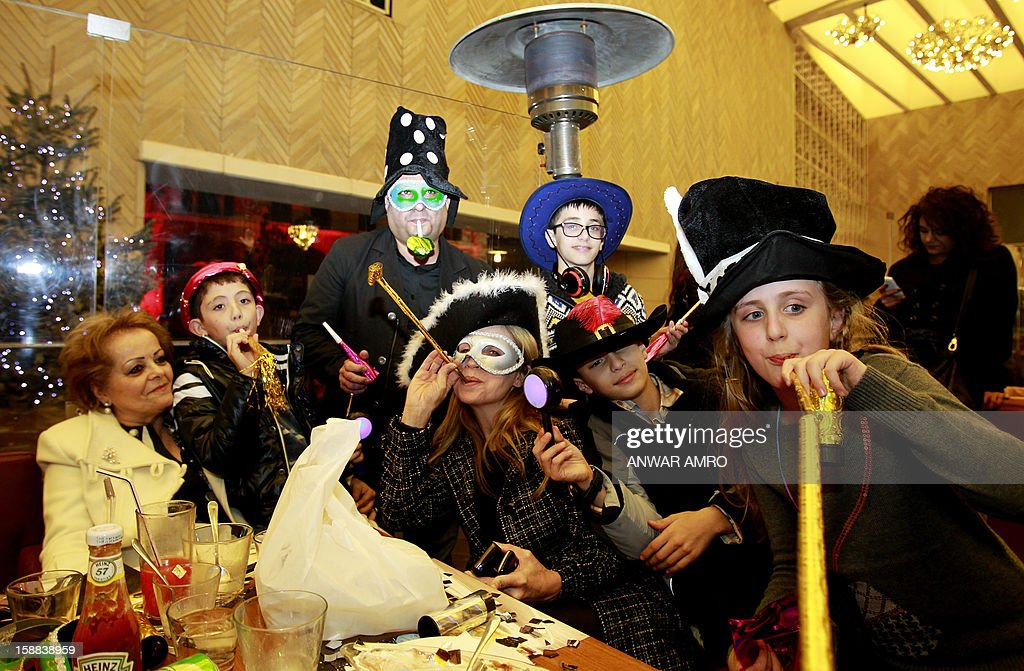 Lebanese people dressed in costumes celebrate on new year's eve in Beirut, early on January 1, 2013. AFP PHOTO / ANWAR AMRO