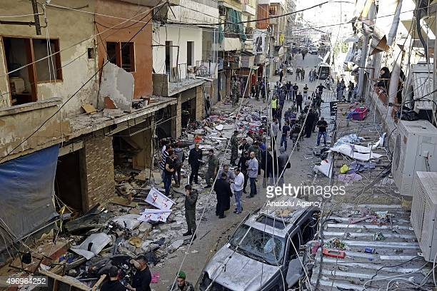 Lebanese people inspect an area where two explosions took place at Dahieh know as Hezbollah stronghold South Beirut Lebanon on November 13 2015 At...