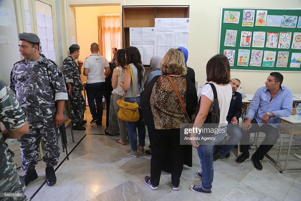 Lebanese people wait in a queue to cast their votes at a polling station during the Lebanese Local elections in Tripoli, Lebanon on May 29, 2016.