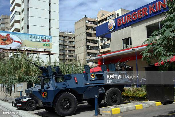 A Lebanese police armoured vehicle is seen stationed outside a US fast food chain KFC store in the northern Lebanese city of Tripoli on September 21...