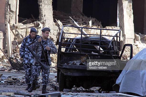 Lebanese policemen secure 24 February 2005 the site where former Lebanese premier Rafiq Hariri was assassinated in downtown Beirut A UN probe team...
