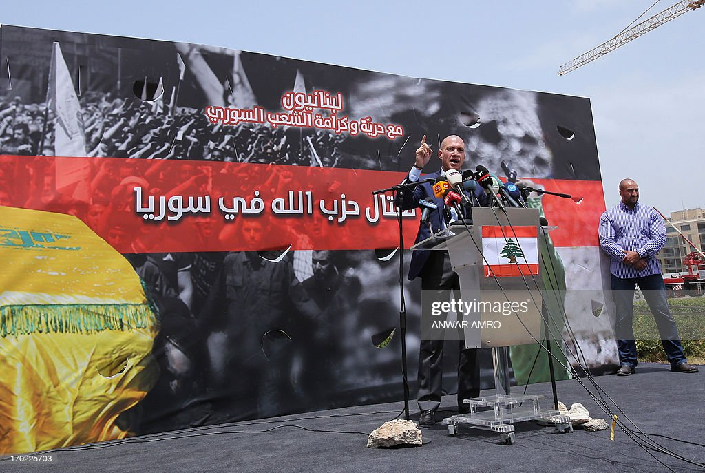 Lebanese political commentator and activist, Saleh Mashnouk speaks during a protest against the involvement of the Shiite movement Hezbollah in fighting in Syria on June 9, 2013 on the Martys square in the Lebanese capital Beirut. A young man has died of his wounds after being injured during a clash that broke out in front of the Iranian embassy on outskirts of Beirut between Hezbollah partisans and protesters.