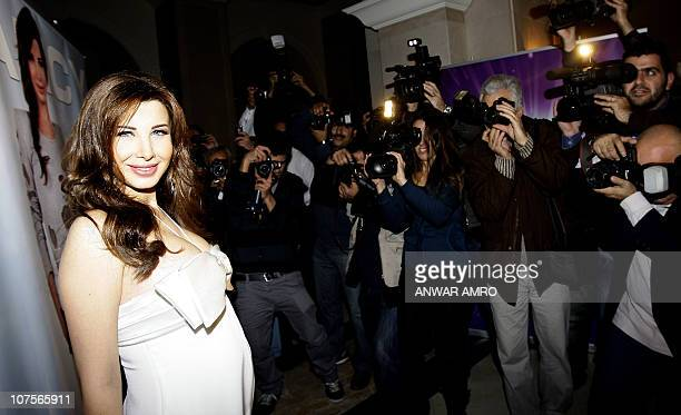 Lebanese pop singer Nancy Ajram poses for pictures during the official launching ceremony of her latest album 'Nancy 7' in Beirut late on December 13...