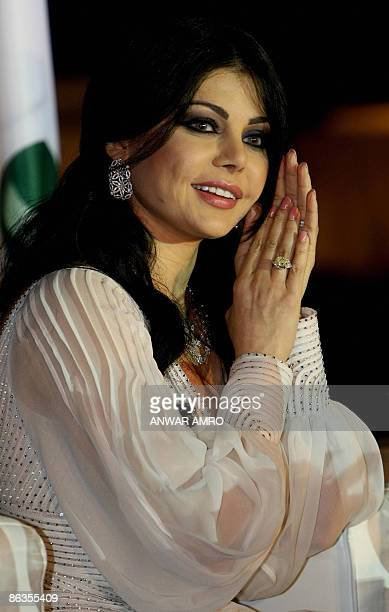 Lebanese pop star Haifa Wehbe applauds during a ceremony to celebrate the signing of a new deal with the Middle East's leading record label Rotana in...