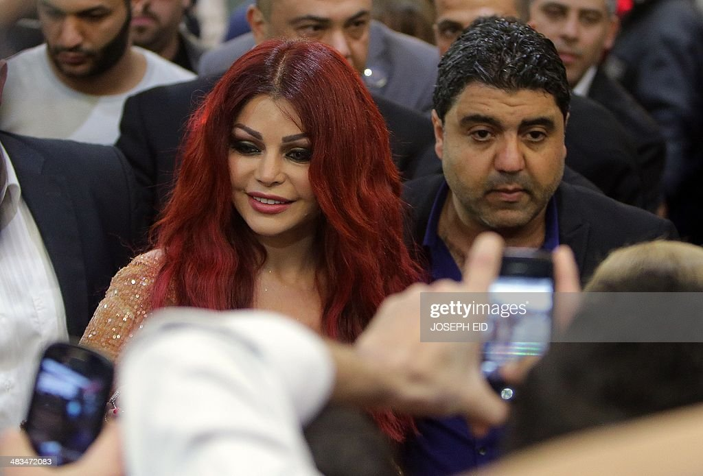 Lebanese pop star Haifa Wehbe arrives for the Premiere of he movie 'Halawet Rooh' at a movie theatre in the town of Dbayeh, North of Beirut on April 8 , 2014. AFP PHOTO/JOSEPH EIDEID