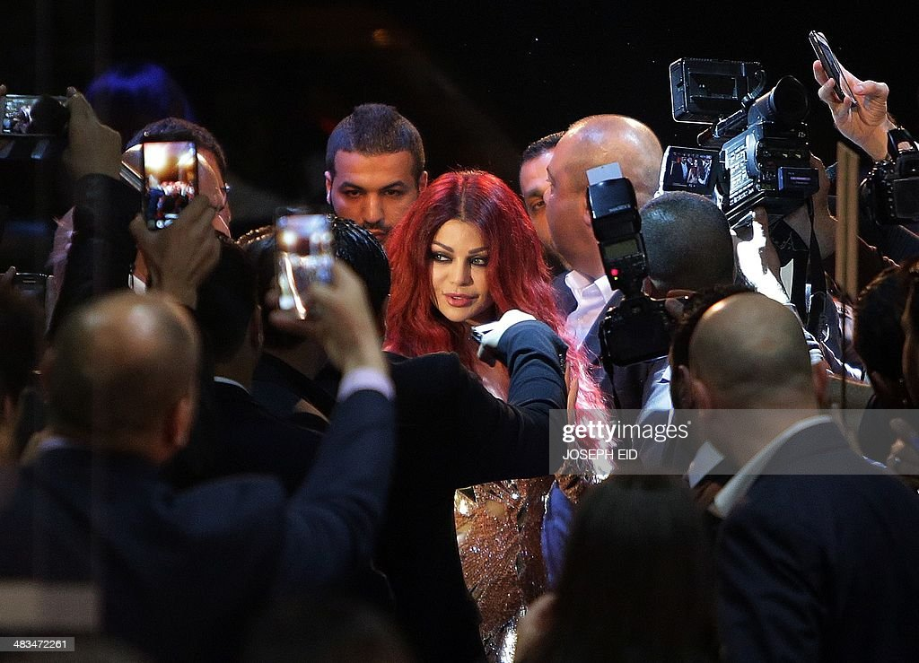 Lebanese pop star Haifa Wehbe arrives for the Premiere of he movie 'Halawet Rooh' at a movie theatre in the town of Dbayeh, North of Beirut on April 8 , 2014.