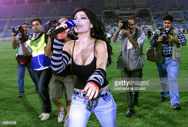 Lebanese pop star Haifa Wehbe performs before the friendly game between Lebanon's Nijmeh team and the Brazilian Flamengo club late 01 October 2003 in...