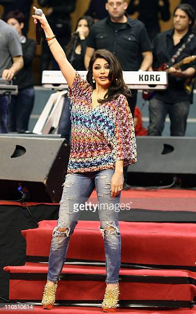 Lebanese pop star Haifa Wehbe performs during an event celebrating mother's day in Beirut on March 21 2011 AFP PHOTO/STR