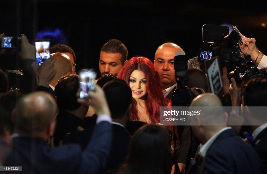 Lebanese pop star Haifa Wehbe smiles as she arrives for the Premiere of he movie 'Halawet Rooh' at a movie theatre in the town of Dbayeh, North of Beirut on April 8 , 2014.