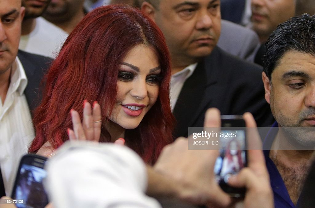 Lebanese pop star Haifa Wehbe waves as she arrives for the Premiere of he movie 'Halawet Rooh' at a movie theatre in the town of Dbayeh, North of Beirut on April 8 , 2014.