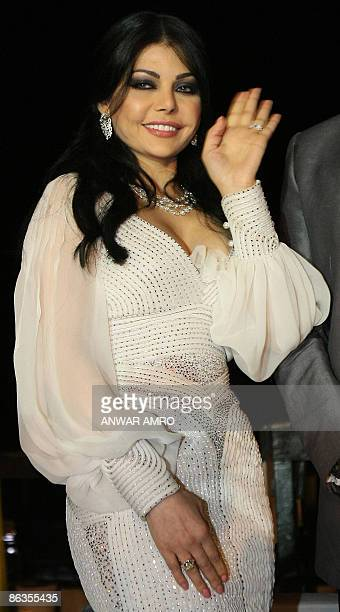 Lebanese pop star Haifa Wehbe waves during a ceremony to celebrate the signing of a new deal with the Middle East's leading record label Rotana in...