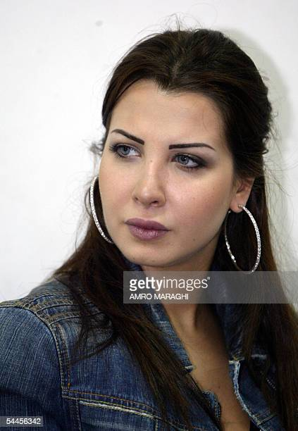 Lebanese pop star Nancy Ajram attends the opening of the children section at Abu Rish hospital in Cairo 03 September 2005 Nancy is in the Egyptian...