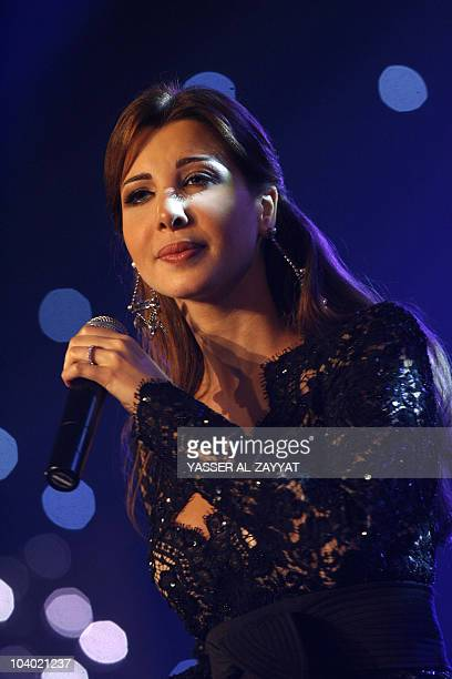 Lebanese pop star Nancy Ajram performs on the second day of Eid alFiter in Kuwait city late on September 11 as Muslim countries celebrate this week...