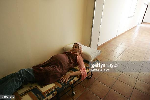 Lebanese pregnant woman from the villages surrounding Tyre is seen after finding shelter at the Rest House Hotel July 22 2006 in Tyre in southern...