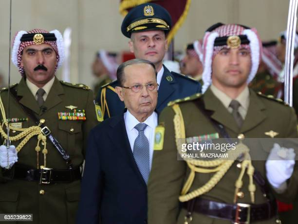 Lebanese President Michel Aoun and Jordan's King Abdullah II review the honour guard during an official welcome ceremony at Marka airport in Amman on...