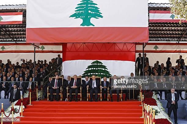 Lebanese President Michel Aoun Parliament Speaker Nabih Berri Caretaker Prime Minister Tamam Salam and new Prime Minister Saad Hariri sit during an...