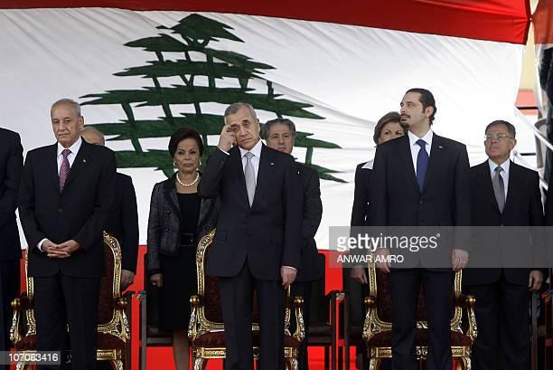 Lebanese President Michel Sleiman scratches his forehead as he attends with Lebanese Parliament Speaker Nabih Berri and Lebanese Premier Saad Hariri...