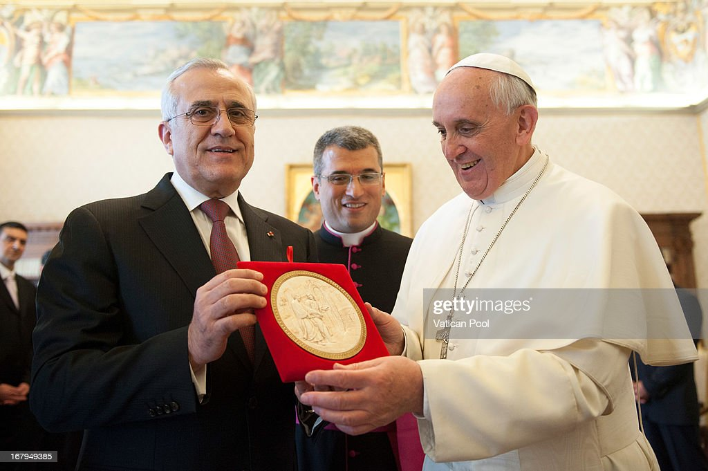Lebanese President Michel Suleiman exchanges gifts with Pope Francis at his private library on May 3, 2013 in Vatican City, Vatican.