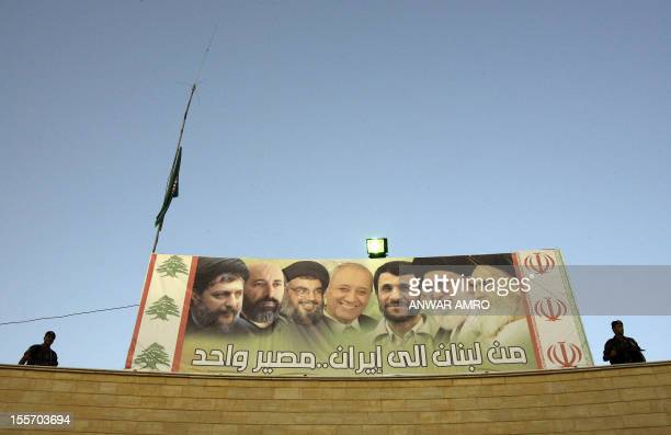 Lebanese presidential guards monitor the openair area where a mass rally organised in honour of Iranian President Mahmoud Ahmadinejad was held on...