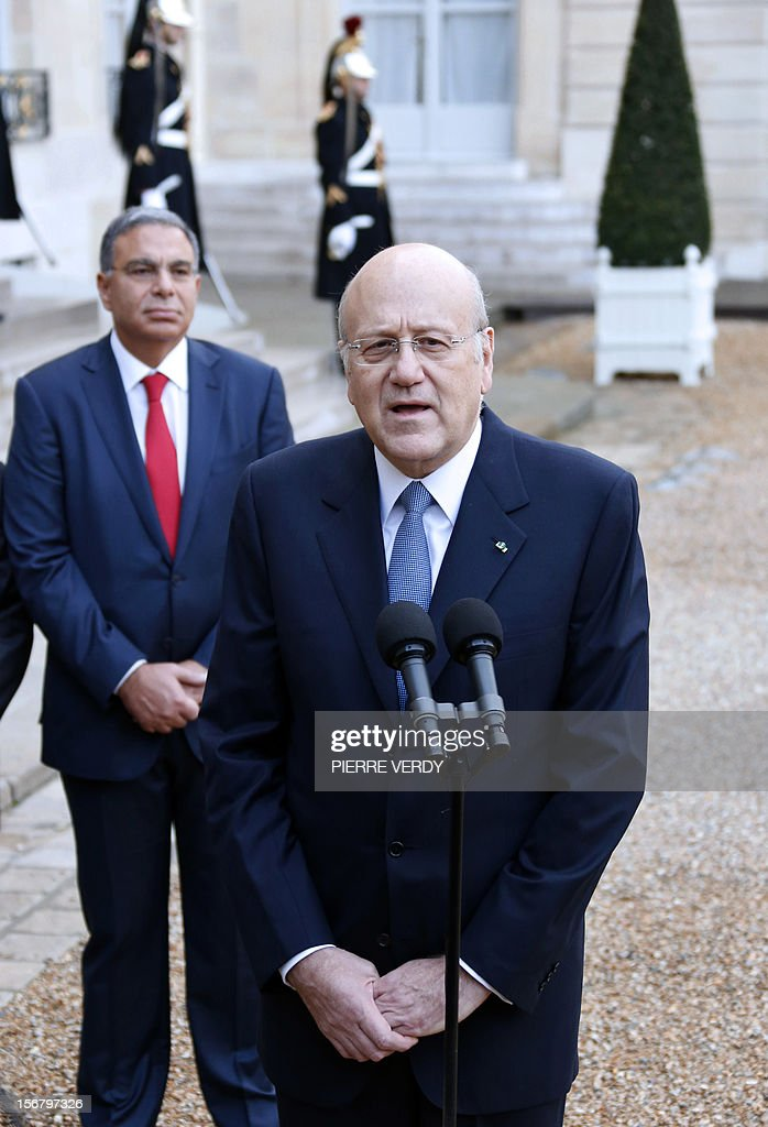 Lebanese Prime Minister Najib Mikati speaks to journalists in the yard of the Elysee presidential Palace in Paris after a meeting with France's President Francois Hollande (L), on November 21, 2012.