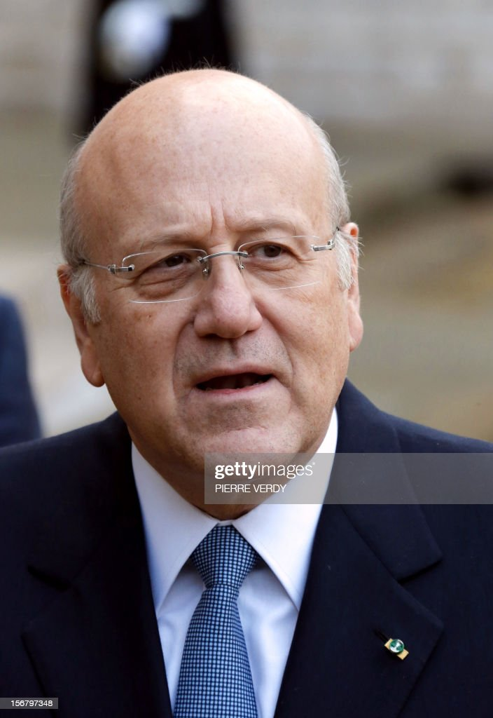 Lebanese Prime Minister Najib Mikati speaks to journalists in the yard of the Elysee presidential Palace in Paris after a meeting with France's President, on November 21, 2012. AFP PHOTO PIERRE VERDY