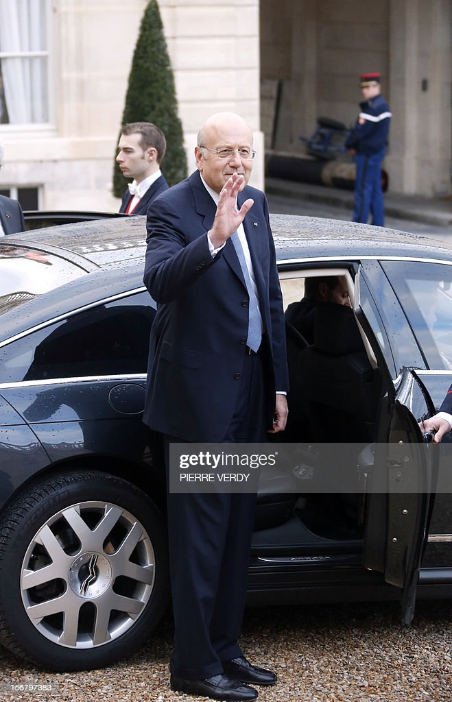 Lebanese Prime Minister Najib Mikati waves as he leaves the Elysee presidential Palace in Paris after a meeting with France's President, on November 21, 2012.