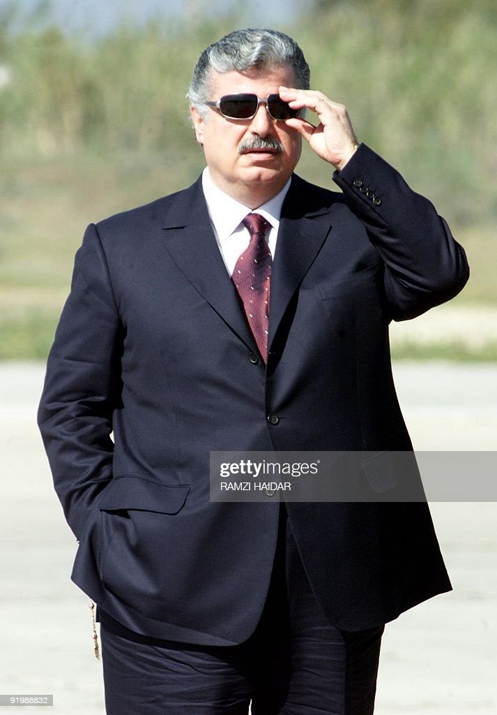 Lebanese Prime Minister <a gi-track='captionPersonalityLinkClicked' href=/galleries/search?phrase=Rafiq+Hariri&family=editorial&specificpeople=549773 ng-click='$event.stopPropagation()'>Rafiq Hariri</a> adjusts his sunglasses as he awaits the arrival of Syrian President Bashar al-Assad at Beirut airport 03 March 2002. Al-Assad arrived in Lebanon on his first visit as head of state for talks with Lebanese President Emile Lahoud ahead of this month's Arab summit in Beirut. While Syria dominates its smaller neighbour politically, no Syrian president has visited Lebanon since Assad's father Hafez in 1975. AFP PHOTO/Ramzi HAIDAR