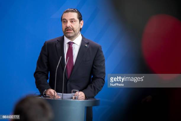 Lebanese Prime Minister Saad Hariri address a statement to the media together with German Chancellor Angela Merkel before a lunch meeting in Berlin...